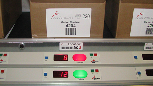 Pack to light system for store cartons above and below rack.