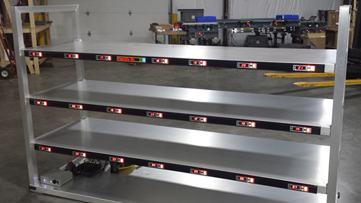 Order picking cart with pick-to-light system.