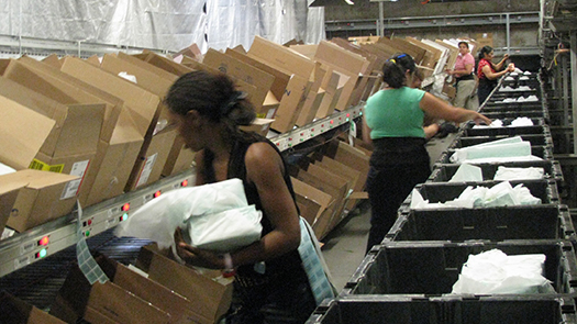 Full case sortation to store level carton quantities with the LP Pack-to-Light put system.