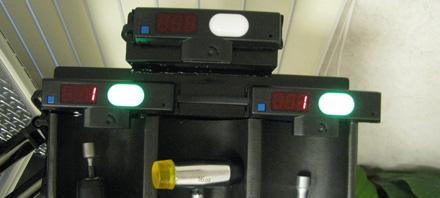 Lightning Pick AW2038PF pick-to-light module with photo-eye sensor on a tool tray.