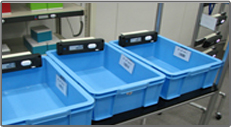 Lightning Pick NW Series wireless pick-by-light system on blue totes.