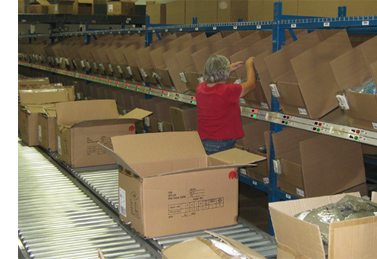 Pack-to-light for sorting full cases of merchandise into retail store replenishment cartons.