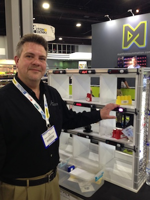 Joe Pelej, marketing manager for Lighting Pick and Pyramid, with a put-to-light system. Photo courtesy of Modern Materials Handling (MMH.com).